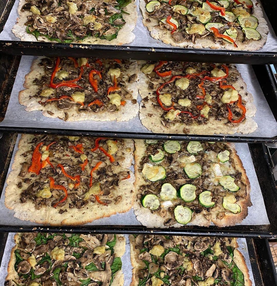 Blossom Bakery Jordan vegan flatbreads stacked on rack