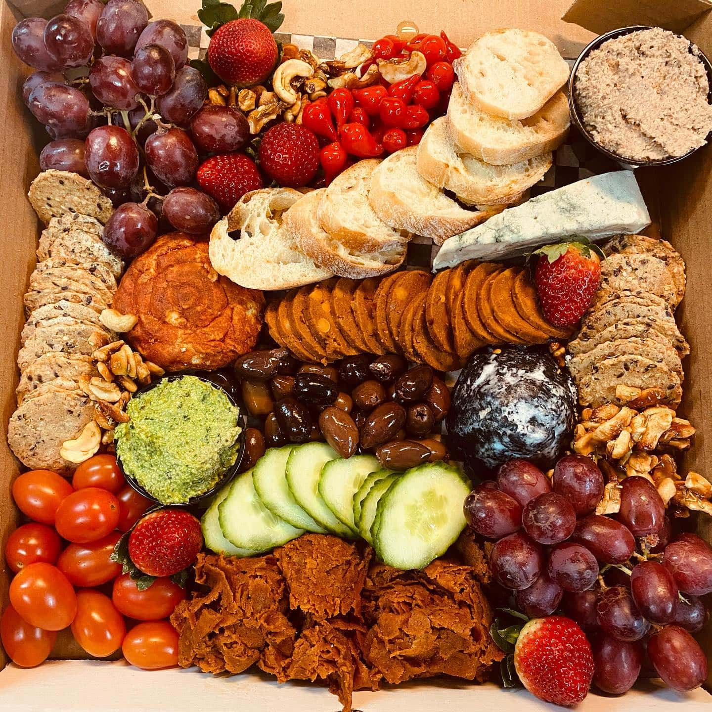 vegan restaurants charcuterie board with vegan cheese and crackers
